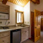 Log cabin kitchen in vacation rental near Zion